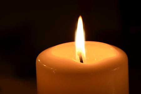 photography of orange pillar candle