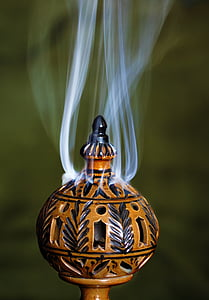 timelapse photography of round brown ornament excreting white smoke