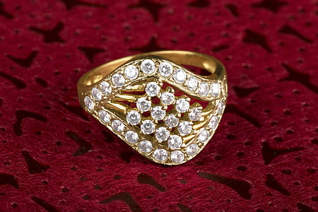 jeweled gold-colored ring
