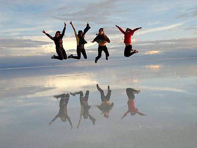 four person jump shot photo
