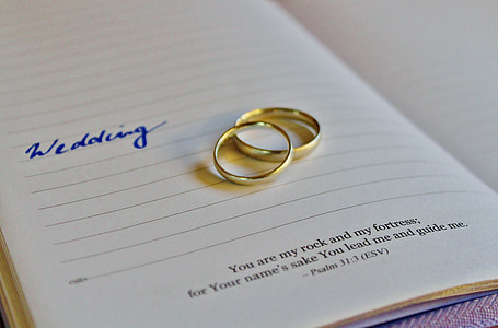 gold-colored wedding bands