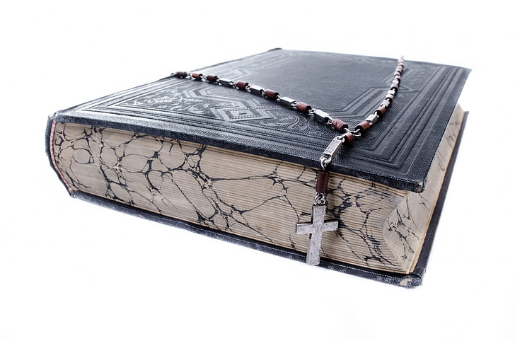 black bible and brown rosary