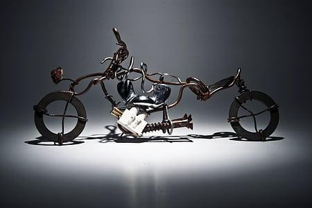 brown scrap metal motorcycle decor