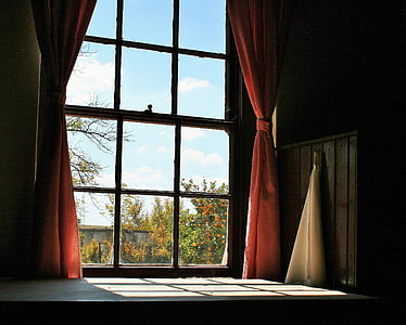 white wooden framed glass pane window with pink curtains
