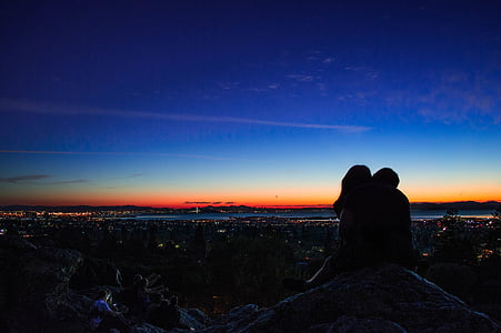 silhouette of two person during nighttime