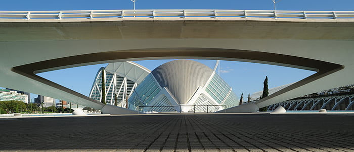 architectural photography of gray dome under bridge