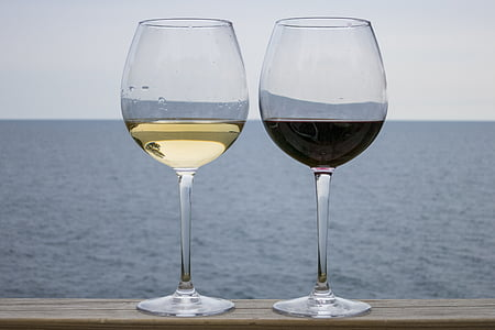 two wine glasses filled with drinks