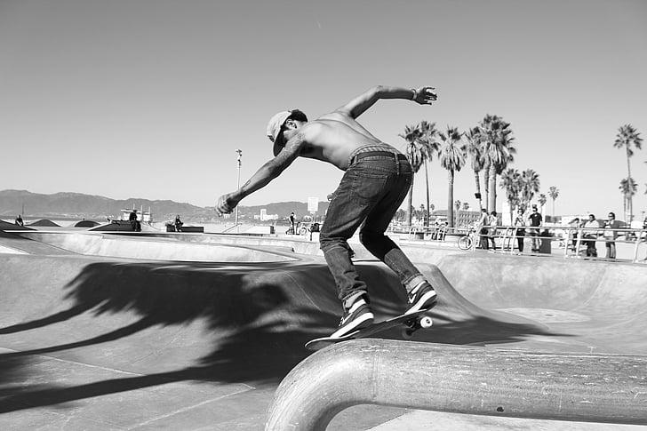 man skateboarding in a park