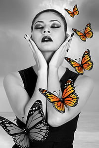 grayscale photo of woman with monarch butterflies