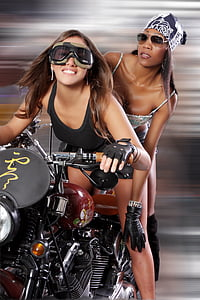 two women riding a motorcycle