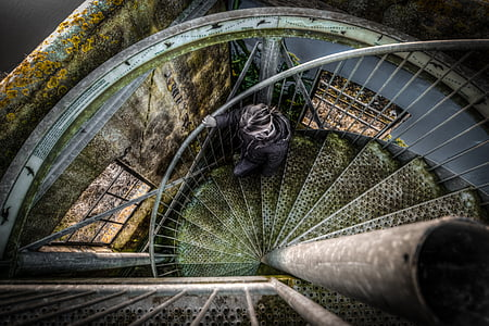 person on gray stairs