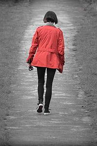 woman walks at road