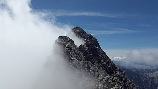 photo of a mountain with clouds