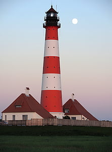 white and red lighthouse tower