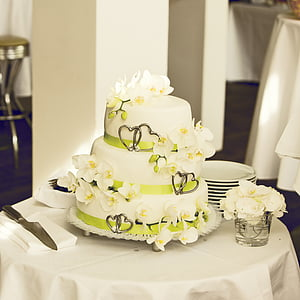 white and green fondant covered cake on table