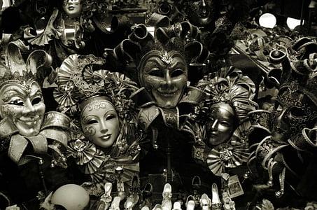 grayscale photo of mask lot