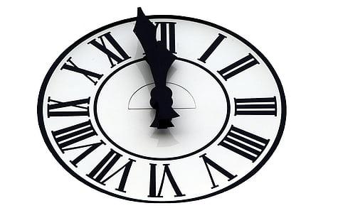 round black analog clock illustration at 11:59