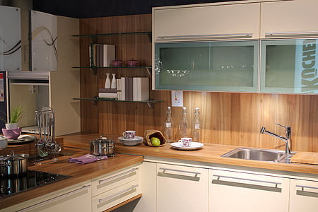 kitchenwares on top of wooden cabinet