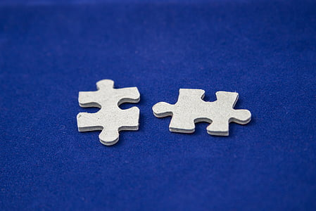 two white jigsaw puzzle pieces