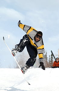 man snowboarding during daytime
