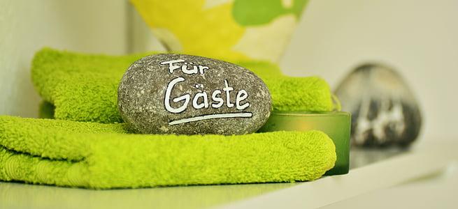 gray stone on green towel