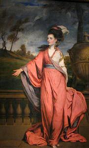 woman in orange dress painting