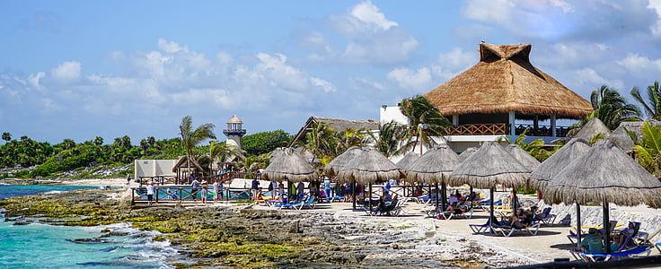 brown hut at beach during daytime