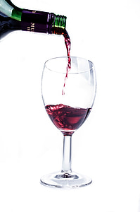 red wine pour on wineglass