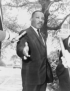 photo of Martin Luther King Jr. rising his right hand