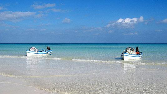 photo of two white and blue boats sailing in open water