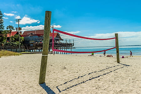 red and white volleyball net on the beach