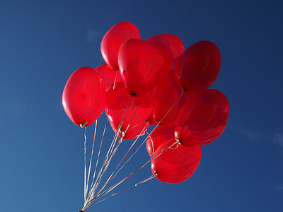 photography of red balloons