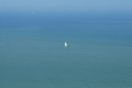white sailboat in middle of sea