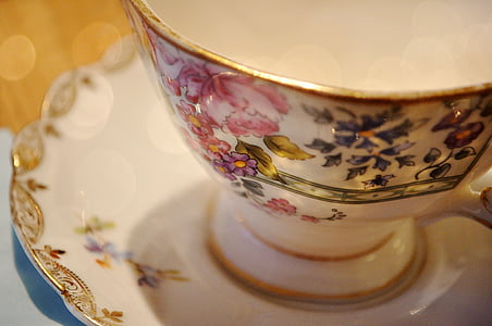 white and multicolored floral ceramic tea cup on white ceramic saucer