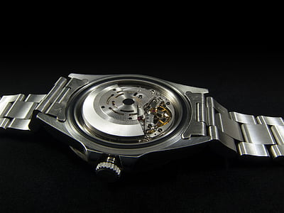 round silver-colored analog watch with missing back lid