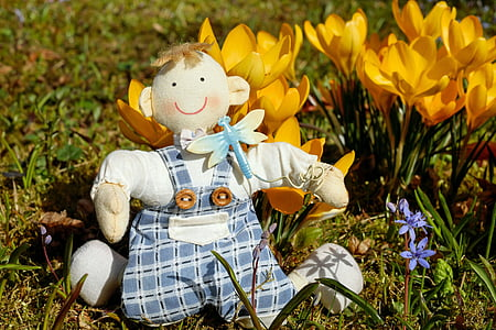 doll with yellow flowers