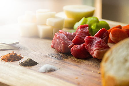 raw meat on top brown wooden surface