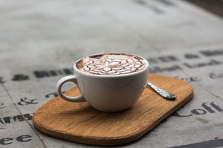 ceramic coffee mug with coffee latte on board