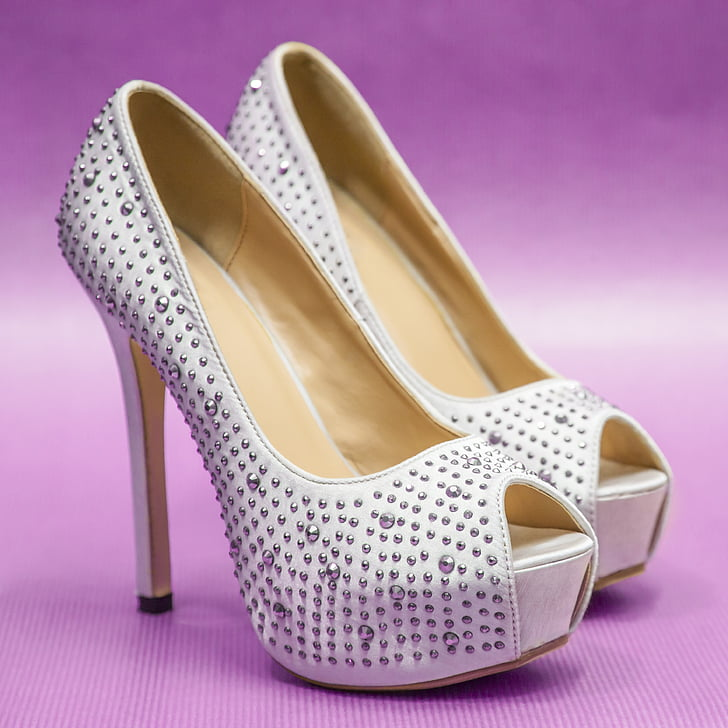 pair of white-and-beige peep-toe stilettos