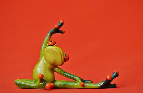 green frog stretching figurine