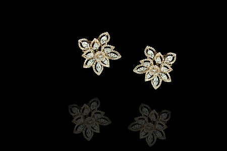 pair of gold-colored floral stud earrings