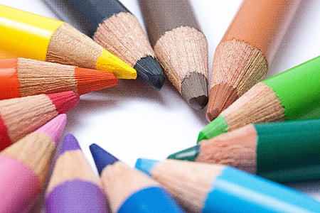 colored pencil arranged with their sharp end forming a circle