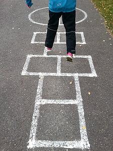person playing street game during daytime