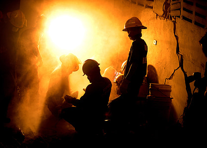 silhouette photo of miners
