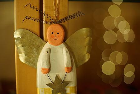 white and orange wooden angel figurine