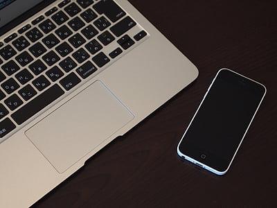 white iPhone 5c and MacBook