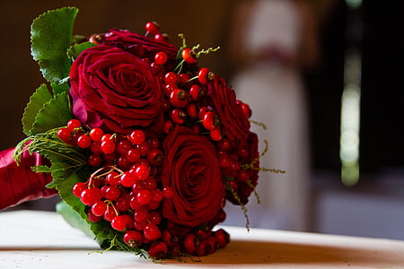 red rose bouquet on brown wooden surface