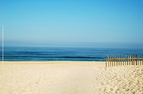 white sand and blue sea under blue sky
