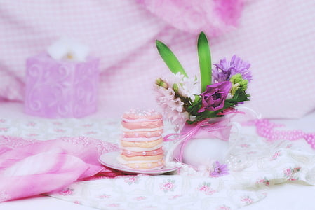 white and purple petaled flowers and round macaroons