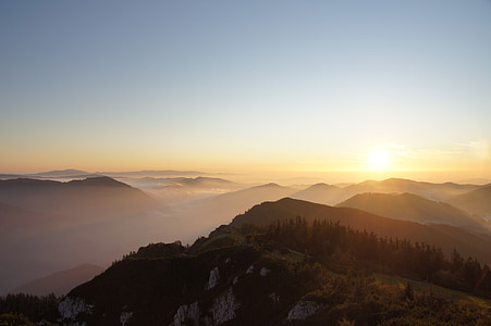 aerial view of mountain with fog during sunrise